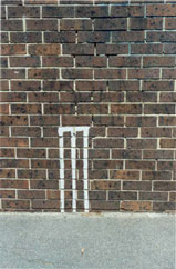 A picture of a set of cricket stumps painted on a wall (by Michael Farrell)